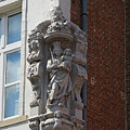 Madonna And Child Statue On The Corner Of A House In Bruges by Louise Heusinkveld