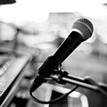 Microphone On Empty Stage by Image By Randymsantaana