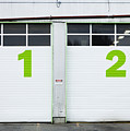 Numbers On Repair Shop Bay Doors by Don Mason