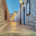 Old Stone Alleyway With Electric Lights by Noam Armonn