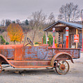 Old Truck And Gas Filling Station by Douglas Barnett