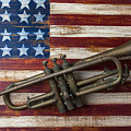 Old Trumpet On American Flag by Garry Gay