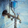 Old Water Tap by Gabriela Insuratelu