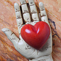 Plam Reader Hand Holding Red Stone Heart by Garry Gay