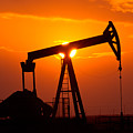Pumping Oil Rig At Sunset by Connie Cooper-Edwards