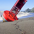 Red Bell Buoy On Beach With Bottle by Garry Gay