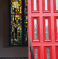 Red Door At Church In Front Of Stained Glass by David Bearden