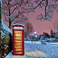 Red Phone Box Covered In Snow by Photo by John Quintero
