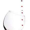 Red Wine Drops Into Wineglass by Dustin K Ryan