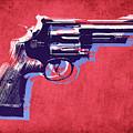 Revolver On Red by Michael Tompsett