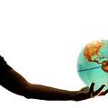 Silhouette Of Man Holding Globe by Sami Sarkis
