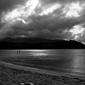 Stand Up Paddlers In Stormy Skies by Lennie Green