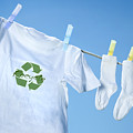 T-shirt With Recycle Logo Drying On Clothesline On A  Summer Day by Sandra Cunningham