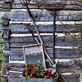 Tall Log Cabin And Garden Tools by Linda Phelps