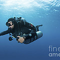 Technical Diver With Equipment Swimming by Karen Doody