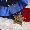 The Medal Of Honor Rests On A Flag by Stocktrek Images