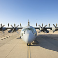 Troops Stand On The Wings Of A C-130 by Terry Moore