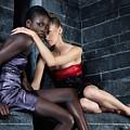 Two Beautiful Women Sitting Together by Oleksiy Maksymenko