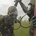 U.s. Air Force Soldier Decontaminates by Stocktrek Images
