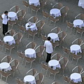 Waiters At Empty Cafe Terrace On Piazza San Marco by Sami Sarkis