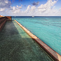 Walls And Moat Of  Fort Jefferson by George Oze