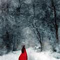 Woman In Red Cape Walking In Snowy Woods by Jill Battaglia