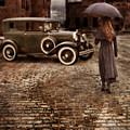 Woman With Umbrella By Vintage Car by Jill Battaglia