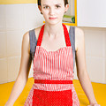 Young House Wife On Yellow Kitchen Background by Jorgo Photography - Wall Art Gallery