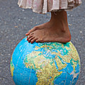Young Woman Standing On Globe by Garry Gay