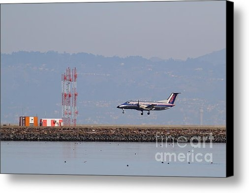 Wingsdomain Art and Photography - Skywest Airlines Jet Airp... Print