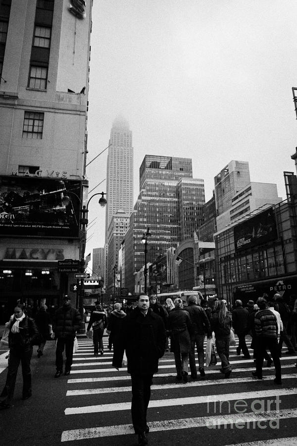 Usa Photograph -  Pedestrians Crossing Crosswalk Outside Macys 7th Avenue And 34th Street Entrance New York Winter by Joe Fox