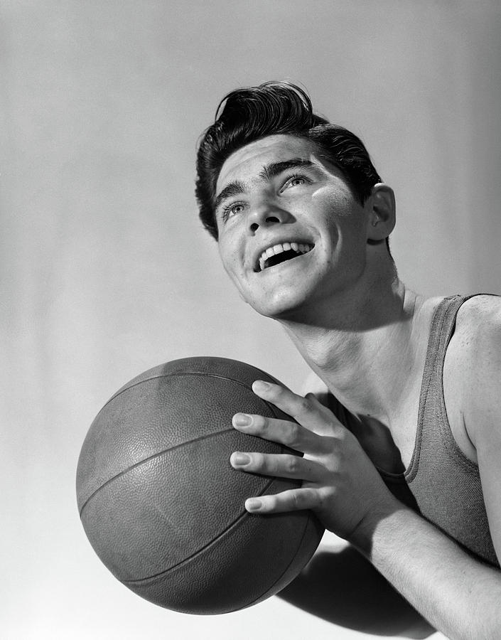 Vertical Photograph - 1950s Smiling Boy Holding Basketball by Vintage Images