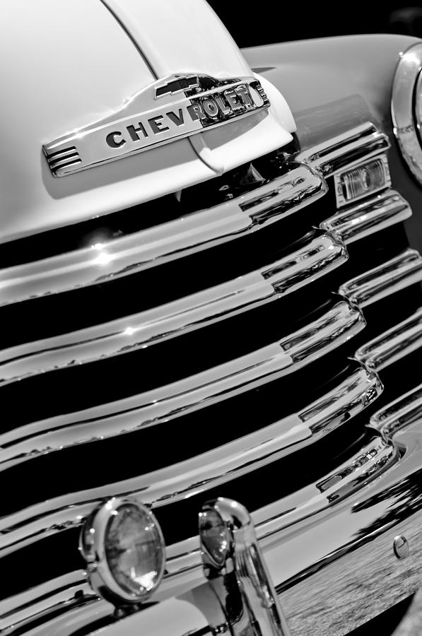 Black And White Photograph - 1956 Chevrolet 3100 Pickup Truck Grille Emblem by Jill Reger