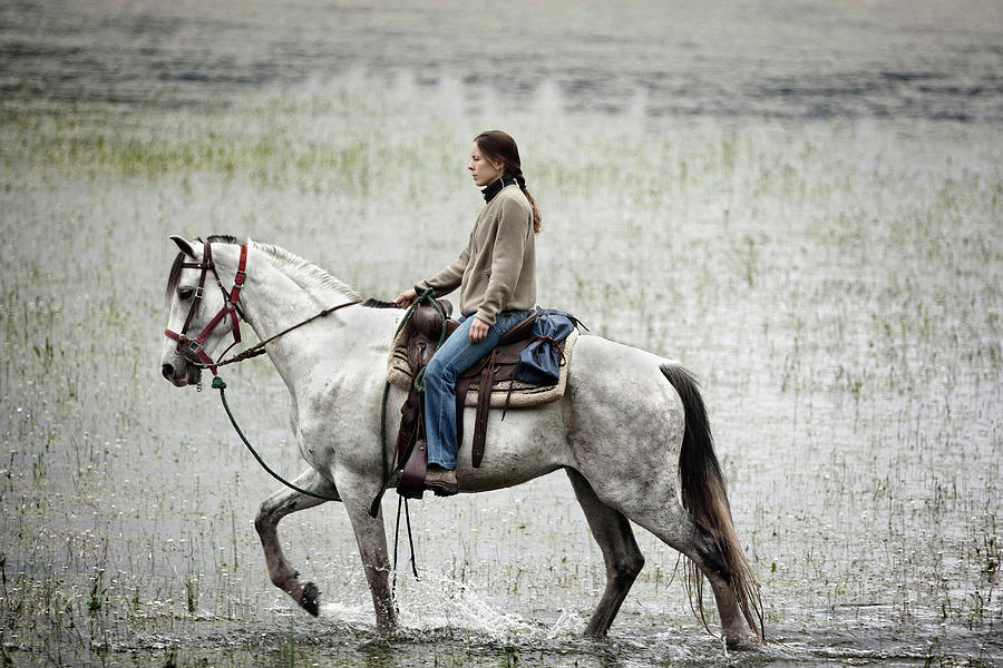 20s Photograph - A Girl Rides A White Horse In The Water by Marcos Ferro