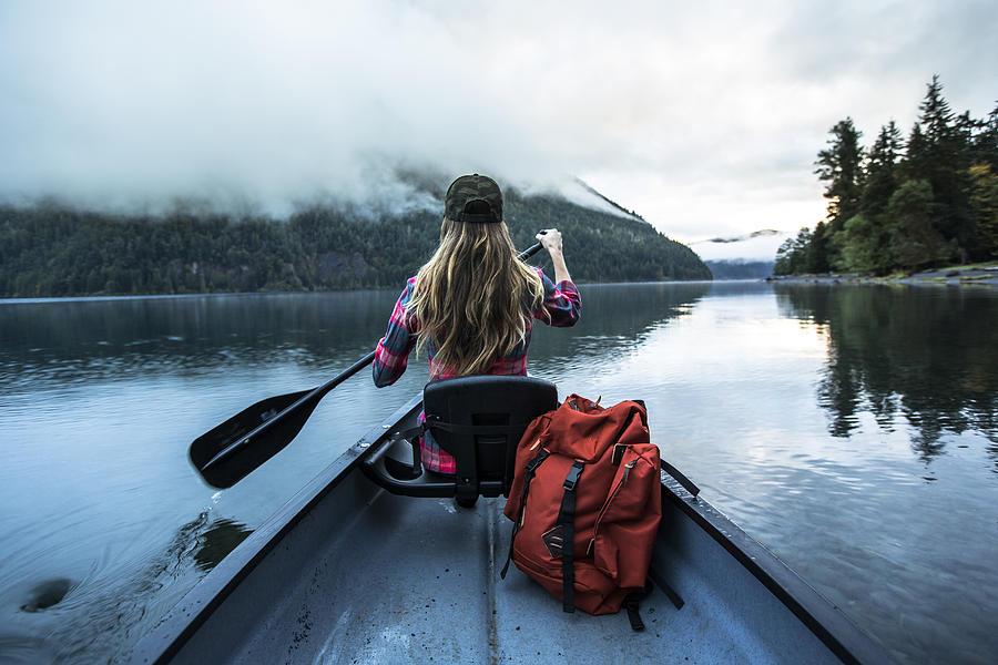 A woman in a canoe. Photograph by Jordan Siemens