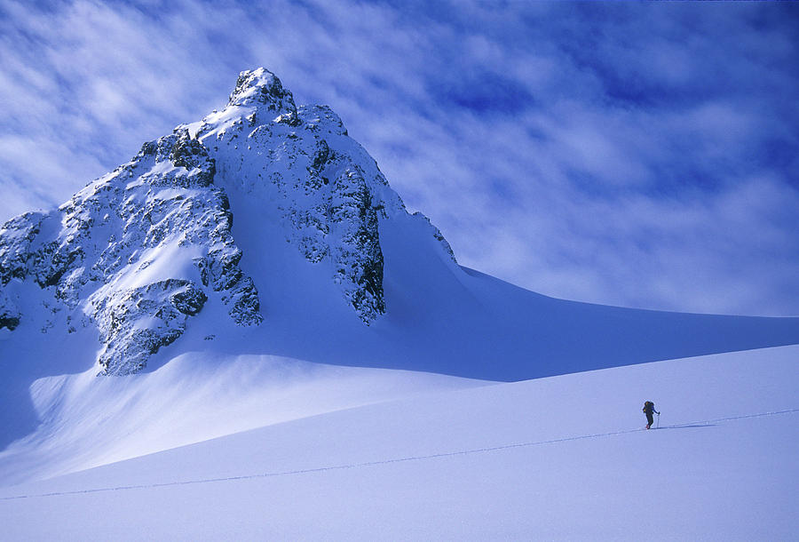 Adventure Photograph - A Woman Ski Tours And Explores 1 by Jimmy Chin