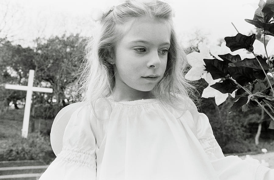 A Young Girl Dressed As A Angel By Ron Koeberer