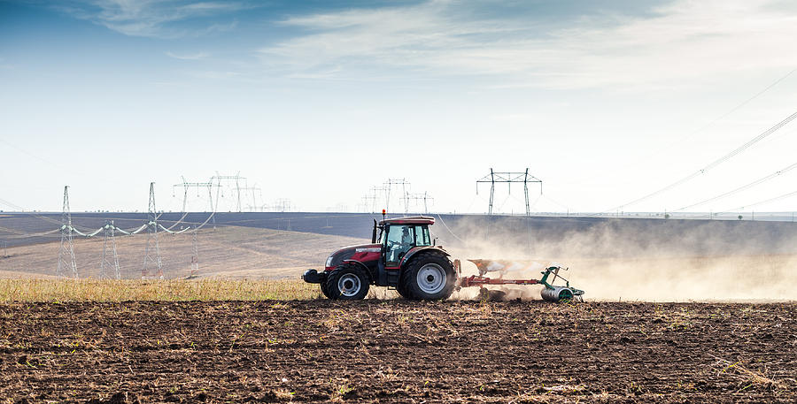 Agriculture Tractor Landscape Photograph by Daniel Barbalata