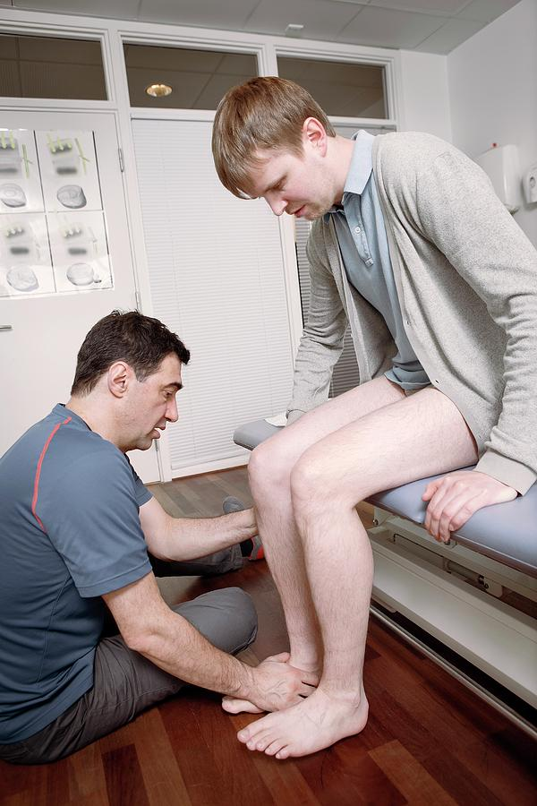 Human Photograph - Ankle Physiotherapy by Thomas Fredberg