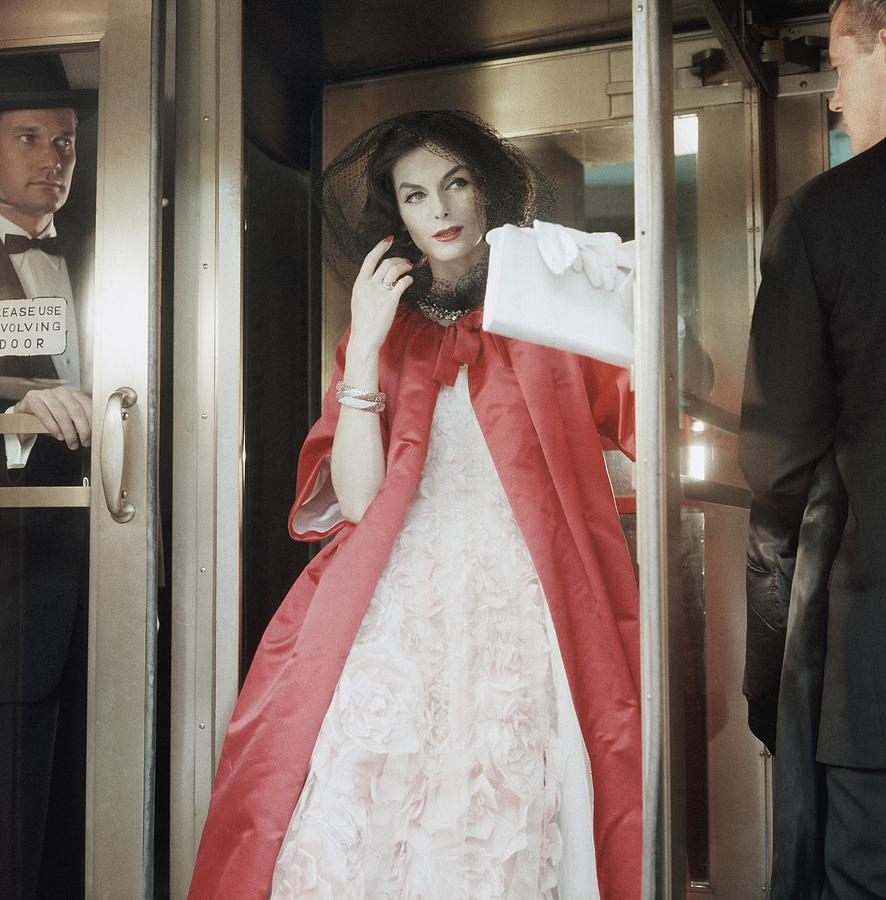 Anne St. Marie Wearing White Dress And Red Coat Photograph by Horst P. Horst