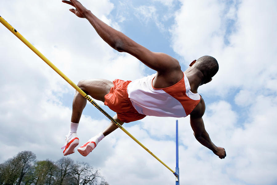 Horizontal Bar Photograph - Athlete Performing A High Jump by Gustoimages/science Photo Library