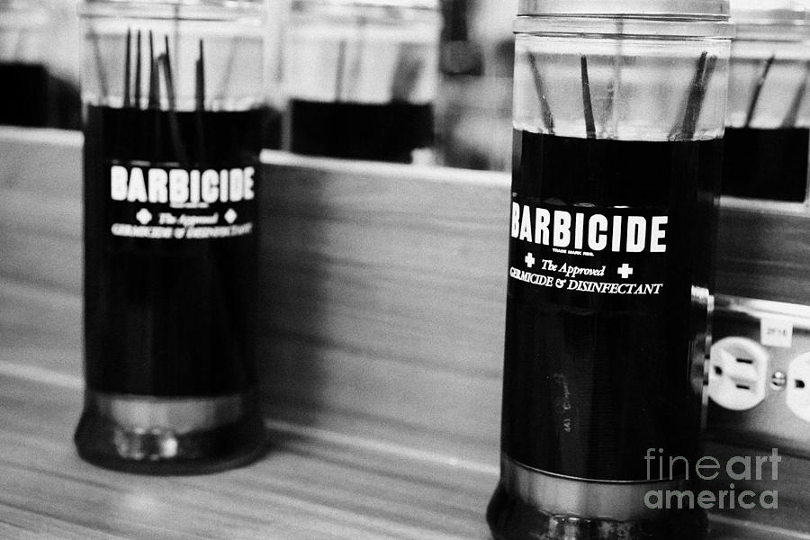 Barbicide Disinfectant Solution In A Hairdressers Salon by Joe Fox