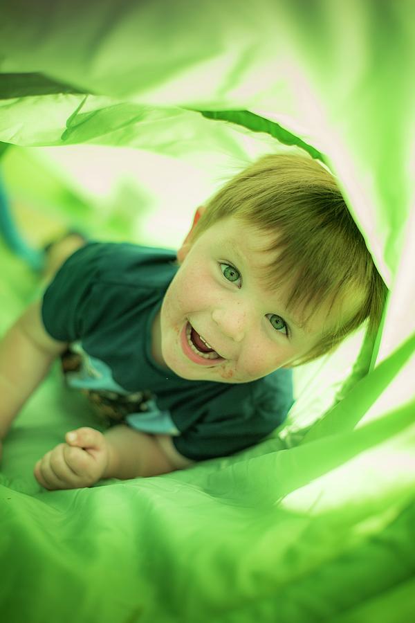 Child Photograph - Boy In Green Tunnel by Samuel Ashfield