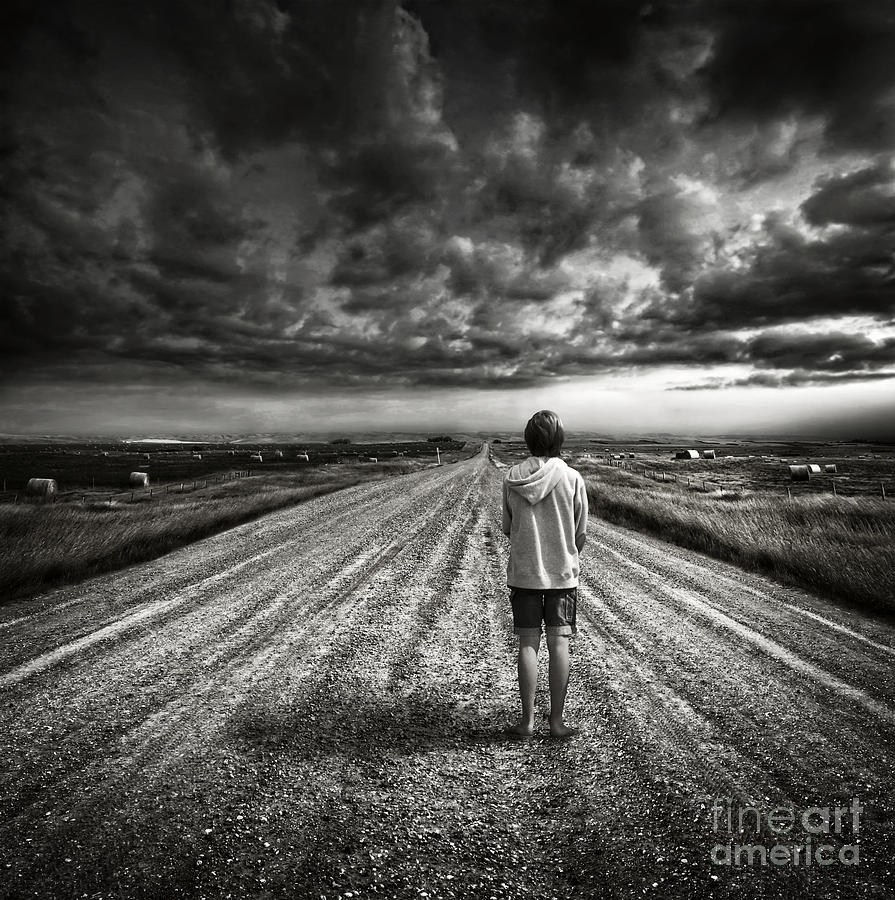 Atmospheric photograph boy walking on dark lonely road in early evening by sandra cunningham