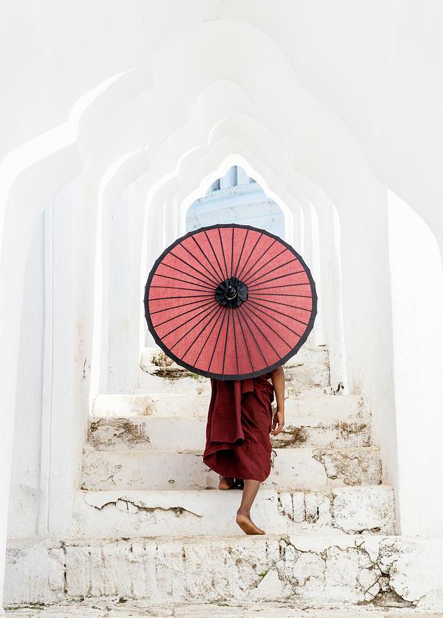 Buddhist Monk Walking Along Temple Photograph by Martin Puddy