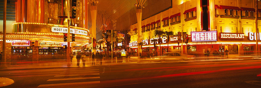 Color Image Photograph - Casino Lit Up At Night, Fremont Street by Panoramic Images