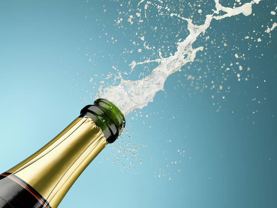 Champagne Exploding From Bottle Photograph by Andy Roberts