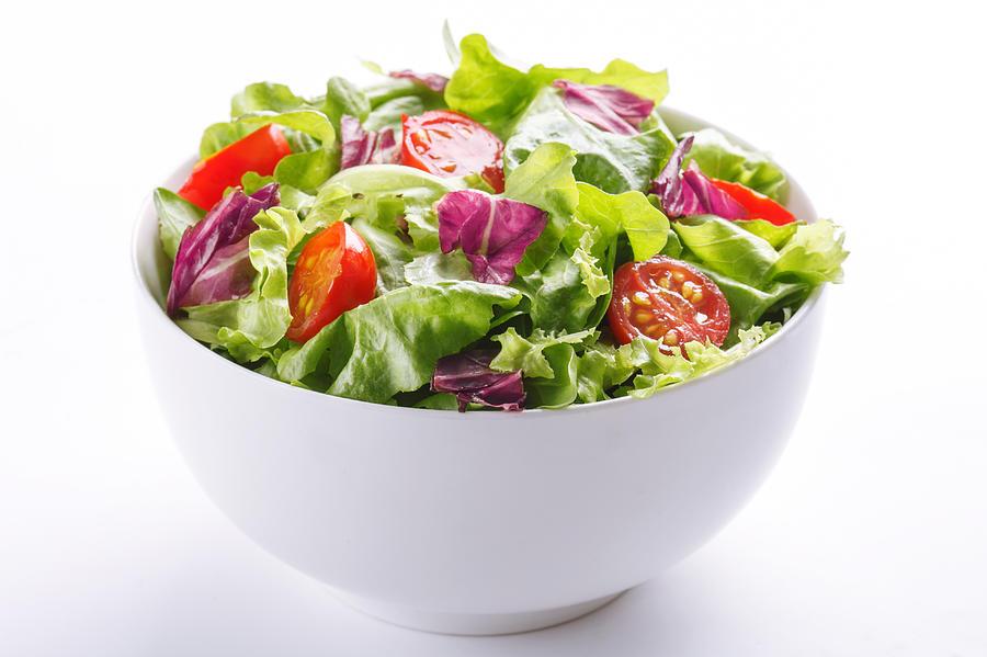 Close-up Of Fresh Salad In Bowl On White Background Photograph by Vesna Jovanovic / EyeEm