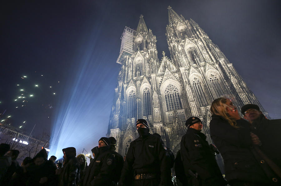 Cologne Celebrates New Years Eve Under Heightened Security Photograph by Maja Hitij