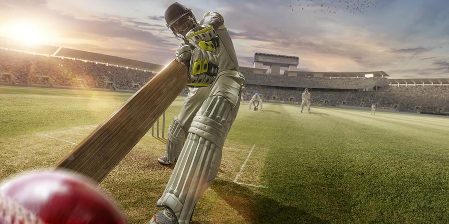 Cricket Batsman Hitting Ball During Cricket Match In Stadium Photograph by Peepo